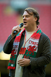 CARDIFF, WALES - Saturday, October 11, 2008: Welsh bass-baritone opera and concert singer Bryn Terfel CBE sings the national anthem 'Hen Wlad Fy Nhadau - Land of my Fathers' before the 2010 FIFA World Cup South Africa Qualifying Group 4 match against Liechtenstein at the Millennium Stadium. (Photo by David Rawcliffe/Propaganda)