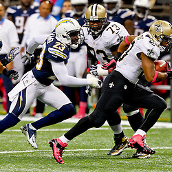 October 7, 2012; New Orleans, LA, USA; New Orleans Saints running back Pierre Thomas (23) breaks away from San Diego Chargers cornerback Quentin Jammer (23) during the third quarter of a game at the Mercedes-Benz Superdome. The Saints defeated the Chargers 31-24.  Mandatory Credit: Derick E. Hingle-US PRESSWIRE