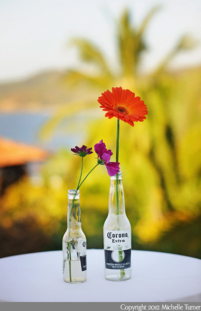 Gerber Daisies in Beer Bottles: Courtney and Storm's Sayulita Wedding at Don Pedro's Palapa.   Image by Sayulita wedding photographer Michelle Turner.