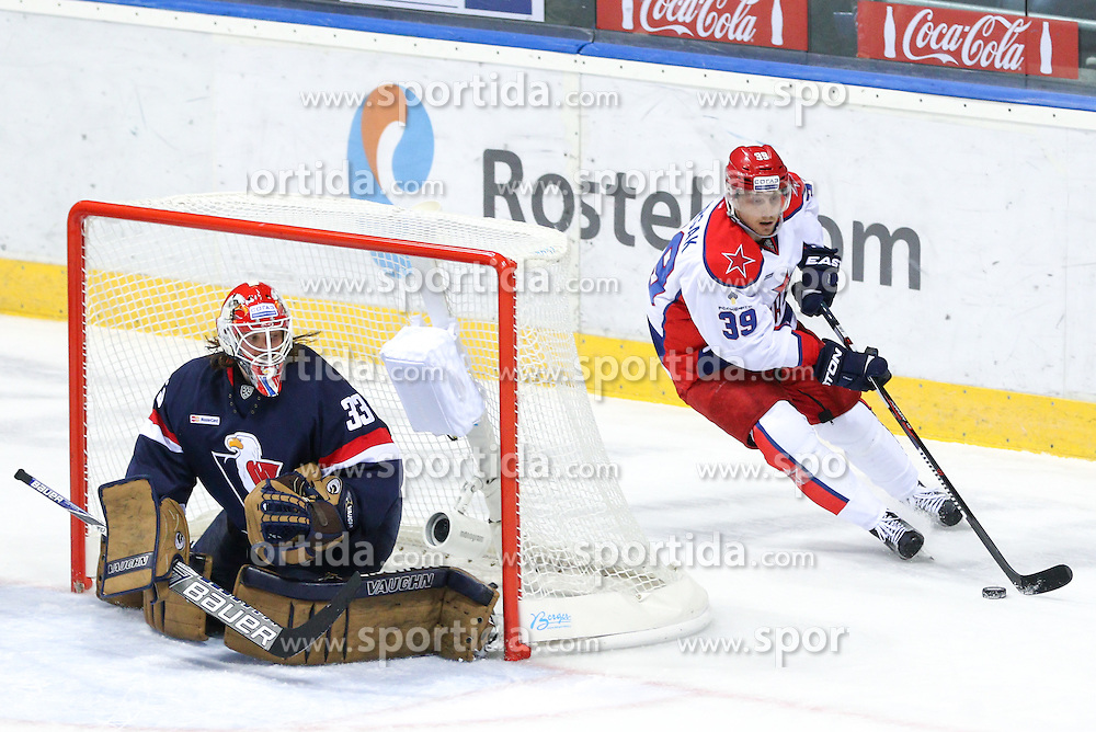 Jan Mursak of CSKA Moscow and Barry Brust of Slovan Bratislava during KHL League ice hockey match between HK Slovan Bratislava and CSKA Moscow, on February 27, 2015 in Ondrej Nepela Arena, Bratislava, Slovakia. Photo by Matic Klansek Velej / Sportida