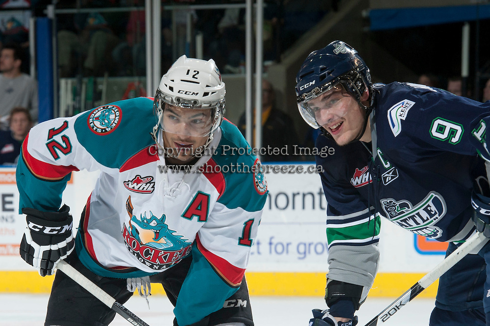 KELOWNA, CANADA - APRIL 5: Tyrell Goulbourne #12 of the Kelowna Rockets shares a few words with Justin Hickman #9 of the Seattle Thunderbirds on April 5, 2014 during Game 2 of the second round of WHL Playoffs at Prospera Place in Kelowna, British Columbia, Canada.   (Photo by Marissa Baecker/Getty Images)  *** Local Caption *** Tyrell Goulbourne; Justin Hickman;