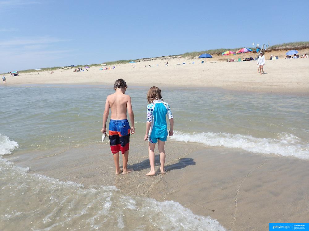 A beach scene in the height of summer on Cisco Beach, Nantucket, as young children look for sea shells. Nantucket Island, Massachusetts, USA. Photo Tim Clayton