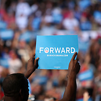 A man holds up a Forward sign as President Barack Obama speaks during his Grassroots event at the Kissimmee Civic Center in Kissimmee, Florida on Saturday, September 8, 2012. (AP Photo/Alex Menendez)