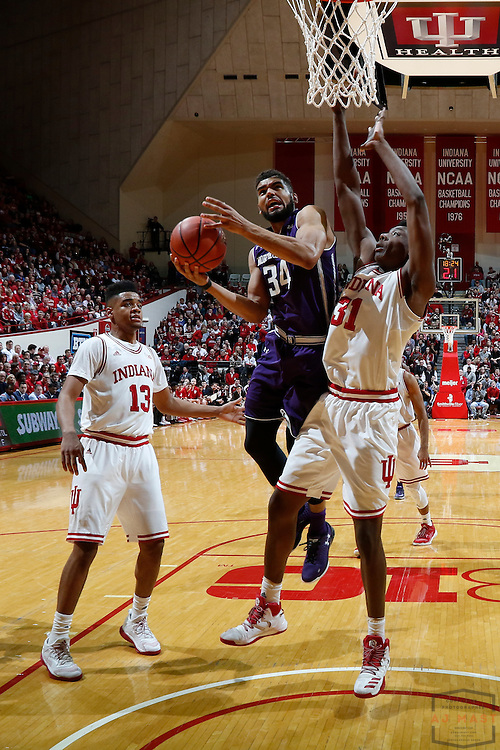 Northwestern guard Sanjay Lumpkin (34) in action as Northwestern played Indiana in an NCCA college basketball game in Bloomington, Ind., Saturday, Feb. 25, 2017. (AJ Mast)