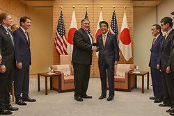 October 6, 2018 - Tokyo, Japan - U.S. Secretary of State Mike Pompeo, left, shakes hands with Japanese Prime Minister Shinzo Abe prior to the start of a bilateral meeting at the official residence of Kantei October 6, 2018 in Tokyo, Japan. Pompeo stopped in Japan for consultations before proceeding to North Korea to continue discussions. (Credit Image: © State Department via ZUMA Wire)