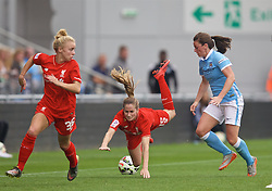 MANCHESTER, ENGLAND - Sunday, August 30, 2015: Liverpool's Ingrid Ryland and Manchester City's Krystle Johnston during the League Cup Group 2 match at the Academy Stadium. (Pic by Paul Currie/Propaganda)