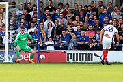 Portsmouth midfielder Gareth Evans (26) with a shot on goal during the EFL Sky Bet League 1 match between AFC Wimbledon and Portsmouth at the Cherry Red Records Stadium, Kingston, England on 13 October 2018.