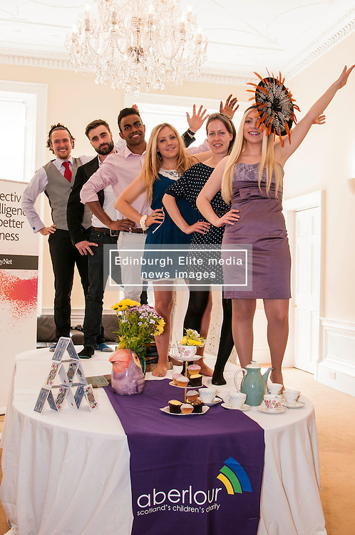 Aberlour children's charity hosted a Mad Hatter's Tea party today to launch their flagship fundraising event, Strictly C, ome Prancing.  Pictured L-R Reece Cambpell, Eddie Robb, Saul Vasakula, Carolyn Kinnaird, Catriona Jack, Adrianna Tsankova  and Catriona Jack,. 18 June 2014   (c) GER HARLEY   StockPix.eu