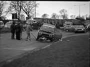 Bomb Attack On Dr Jim Donovan.  (P8)..1982..06.01.1982..01.06.1982..6th January 1982..This morning Dr Jim Donovan, Senior Forensic Scientist with the Garda Technical Bureau, was critically injured when a bomb planted in his car exploded. Due to his ongoing investigative work, it is suspected that there may be an IRA or Dublin criminal gang involvement in the attack...Image shows the rush hour traffic being diverted around the bombed out vehicle.