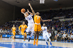 Kentucky guard Makayla Epps, left, drives to the basket on Tennessee guard Jordan Reynolds in the second half.<br /> <br /> The University of Kentucky hosted the University of Tennessee, Monday, Jan. 25, 2016 at Memorial Coliseum in Lexington .