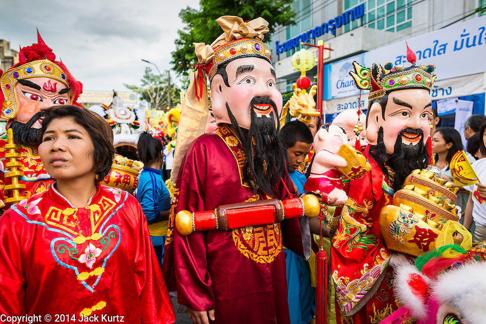 24 SEPTEMBER 2014 - BANGKOK, THAILAND: Characters representing Taoist Gods lead the Vegetarian Festival Parade in Bangkok. The Vegetarian Festival is celebrated throughout Thailand. It is the Thai version of the The Nine Emperor Gods Festival, a nine-day Taoist celebration beginning on the eve of 9th lunar month of the Chinese calendar. During a period of nine days, those who are participating in the festival dress all in white and abstain from eating meat, poultry, seafood, and dairy products. Vendors and proprietors of restaurants indicate that vegetarian food is for sale by putting a yellow flag out with Thai characters for meatless written on it in red.    PHOTO BY JACK KURTZ