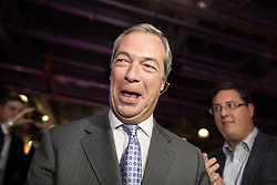 © Licensed to London News Pictures . 25/09/2015 . Doncaster , UK . NIGEL FARAGE leaves the hall after speaking at the 2015 UKIP Party Conference at Doncaster Racecourse , this afternoon (Friday 25th September 2015) . Photo credit : Joel Goodman/LNP