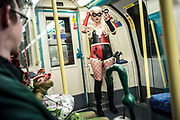 UNITED KINGDOM, London: 27-28 May 2017 A cosplay fan dressed as the DC comic character Harlequin makes some final adjustments as she makes her way to the MCM London Comic Con. <br /> The comic convention, which will be visited by tens of thousands of comic book and cosplay fans, is being held at London's ExCel this weekend. Rick Findler / Story Picture Agency