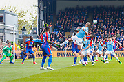 Manchester City defender Vincent Kompany (4) heads the balls towards Manchester City midfielder David Silva (21) during the Premier League match between Crystal Palace and Manchester City at Selhurst Park, London, England on 14 April 2019.
