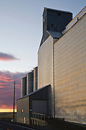 grain elevator and road at sunset in palousse washington