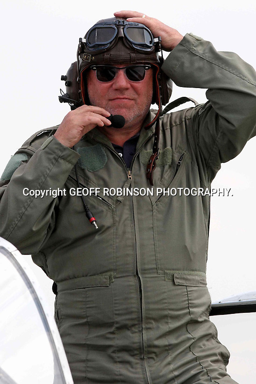 "PIC SHOWS ACTOR RAY WINSTONE AFTER FLYING IN A P-51 MUSTANG AT THE IMPERIAL WAR MUSEUM DUXFORD,CAMBS,ON TUESDAY AFTERNOON... Actor Ray Winstone got in some play time today (Tues) as he flew in aeroplane ahead of filming upcoming movie The Sweeney this autumn...Ray, who will play Flying Squad detective Jack Regan in the film, took to the skies in a P-51 Mustang at The Imperial War Museum in Duxford, Cambs...""Ray is a very keen aviation fan and has often spoken of his desire to learn to fly a plane,"" said a spokesman for the museum...Afterwards  Ray said he  was thrilled with the flight and claimed he did not throw up,''Men from the East End are never sick"" he said...Based on the original ITV cult show, The Sweeney will be a modernization of the London Flying Squad, directed by Nick Love...It will be set in present day England and be packed full of fast cars and action...Ray will star alongside Ben Drew (Plan B) who will play his partner George Carter...SEE COPY CATCHLINE Ray Winstone plane"