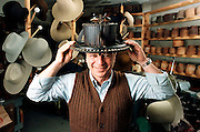 A hat maker with some of the vintage tools he uses in Tulsa, OK.