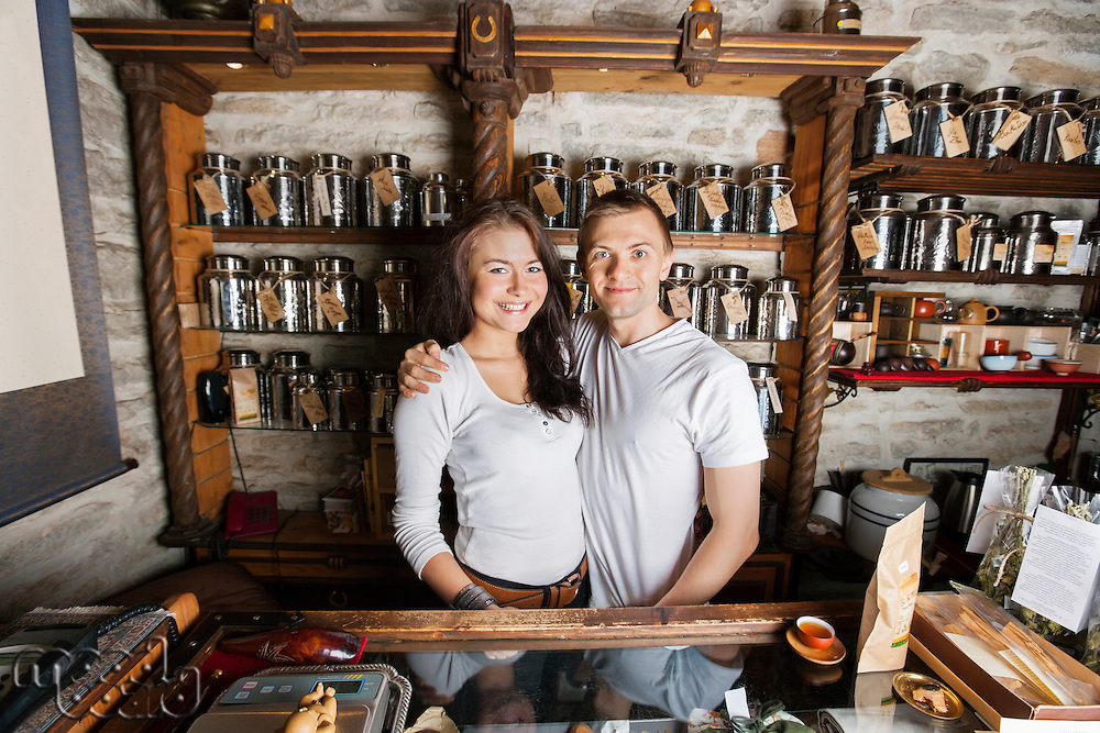 Portrait of happy couple standing together in tea store
