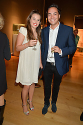 KATIE WATKINS and MARK JORDAN at a party to celebrate the publication of Capability Brown & Belvoir - Discovering a lost Landscape by The Duchess of Rutland, held at Christie's, 8 King Street, St.James, London on 7th October 2015.