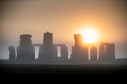 © Licensed to London News Pictures. 24/07/2018. Amesbury, UK.  The sun rises over a misty Stonehenge on another hot day as the heatwave continues. Photo credit: Peter Macdiarmid/LNP