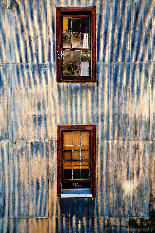 A colorful sheet metal adorned house with windows in Valapairaso Chile. UNESCO World Heritage city.