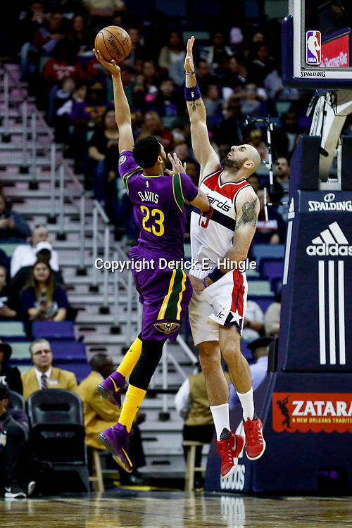 Jan 29, 2017; New Orleans, LA, USA; New Orleans Pelicans forward Anthony Davis (23) shoots over Washington Wizards center Marcin Gortat (13) during the first quarter of a game at the Smoothie King Center. Mandatory Credit: Derick E. Hingle-USA TODAY Sports