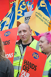Ian Lawther of The GEC (left) and Womens Officer Est Midlands Branch Wendy Toner (right).Members PCS union hold a rally outside Nick Cleggs Constituency Office, to raise awareness of the fact that this month will see the first  increased contributions coming out of their salaries to pay for the changes to public sector pensions. It is the first in a series of hands off our pensions red card protest outside key ministerial constituencies over the Easter recess...http://www.pauldaviddrabble.co.uk.14 April 2012 .Image © Paul David Drabble