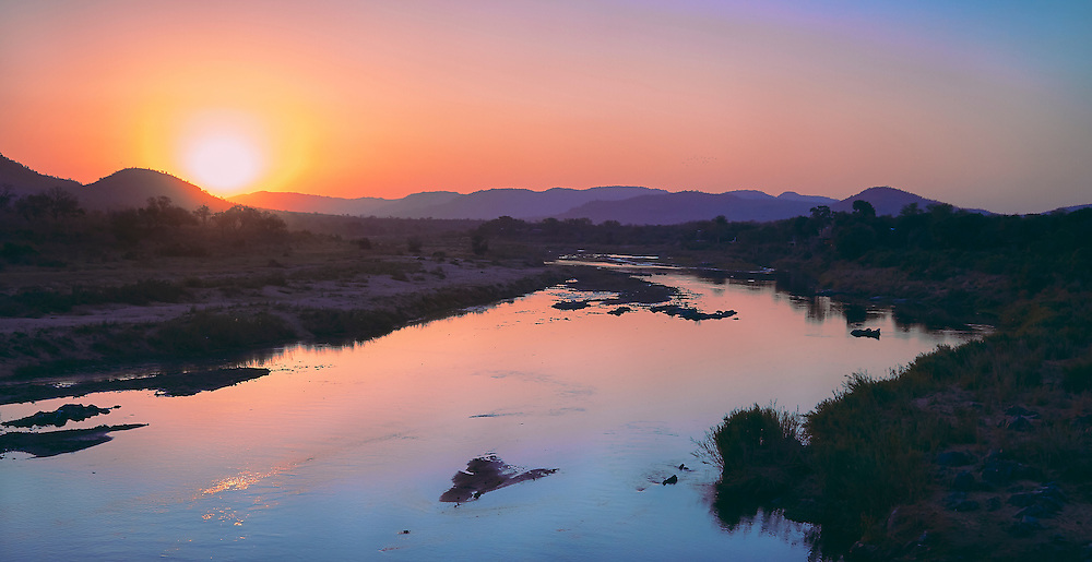 Sunset from Crocodile Bridge overlooking Crocodile River in Kruger National Park in South Africa