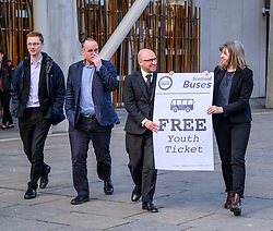 Scottish Greens, Free Bus Travel, 27 February <br /> <br /> Ahead of the budget debate this afternoon, Scottish Greens Parliamentary Co-Leaders Alison Johnstone MSP and Patrick Harvie MSP along with the Green MSP group staged a photocall outside the Scottish Parliament to celebrate their free bus travel for under 19s budget win. <br /> <br /> The Scottish Greens yesterday announced that a deal had been struck on free bus travel, more money for councils, extra resource for community safety and an additional £45 million package to tackle fuel poverty and the climate emergency.<br /> <br /> Pictured:  (left to right) Ross Greer MSP, Andy Wightman MSP, Patrick Harvie MSP and Alison Johnstone MSP<br /> <br /> Alex Todd | Edinburgh Elite media