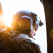 SPC Daniel Tucker, Crew Chief with C Co. 3-2 GSAB, 2 ID clears the aircraft as the dawn sun rises