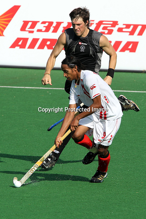 Kenny Pereira of Canada attacks during the hockey match between New Zealand and Canada during the XiX Commonwealth Games  held at the MDC Stadium in New Delhi, India on the  10 October 2010<br /> <br /> Photo by:  Ron Gaunt/photosport.co.nz