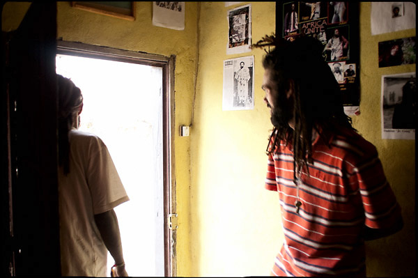 """M.P.  and Mesay (right and left), age 23 and 25,  both Rasta, one comes from Barbedos and the other is from Ethiopia, spend few hours in a  small laboratory, where M.P. produces a particular ganja wine. Shashemene, south Ethiopia, on friday, March 21 2008.....""""Shashamene or Shashemene (ethiopian name), located in the Oromia Region of Ethiopia, is """"the place"""", the ancestral homeland. For the whole Rastafarians repatriation to Africa or to Zion or to the Promise Land is the first goal. Rastas assert that """"Mount Zion"""" is a place promised by Jah and they  claim themselves to represent the real Children of Israel in modern times. During the last years of the 40's, Emperor Haile Selassie I, considerated from that movement incarnation of God, donated 500 acres of his private land to members and other settlers from Jamaica including other parts of the Caribbean..The Rastafarian settlement in Shashamane was recently reported to exceed two hundred families. In January 2007 it organized an exhibition and a bazaar in the city. It was also reported recently prior to the Ethiopian Millennium that various pro-Ethiopian World Federation groups, consisting of indigenious Ethiopians and Rastafarians, have given support to one of many five year plans proposed for sustainable development of Shashamene, Ethiopia."""""""