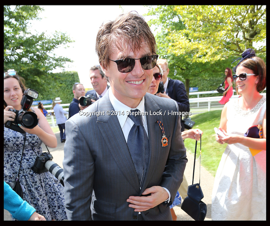 Image licensed to i-Images Picture Agency. 31/07/2014. Goodwood. United Kingdom. Tom Cruise  arrives  at Ladies Day at Glorious Goodwood.  Picture by Stephen Lock / i-Images