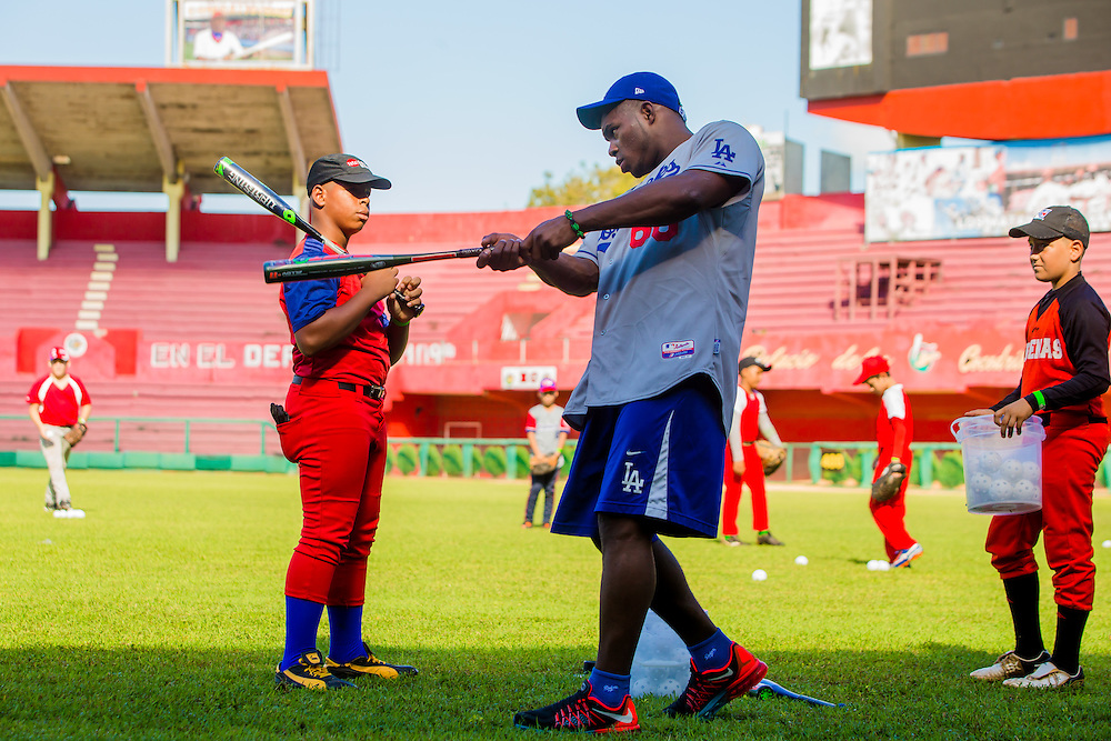 Yasiel Puig works with young ballplayers at Victoria de Girón Stadium in Matanzas a goodwill trip to Cuba. (Photo by Chip Litherland/The Players' Tribune)