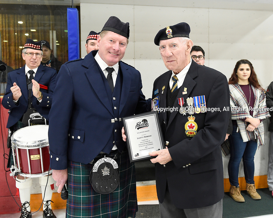 PICKERING, - Feb 19, 2016 -  Ontario Junior Hockey League game action between Whitby and Pickering at the Pickering Recreation Complex, ON. Glen Healey presents a Volunteer Award to Scotty Ramage during a special pre-game ceremony.<br /> (Photo by Andy Corneau / OJHL Images)