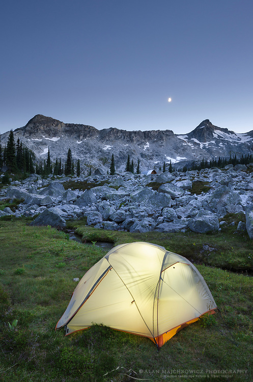 Illuminated tent in backcountry camp at dusk, in Marriott Basin near Wendy Thompson Hut, Coast Mountains British Columbia