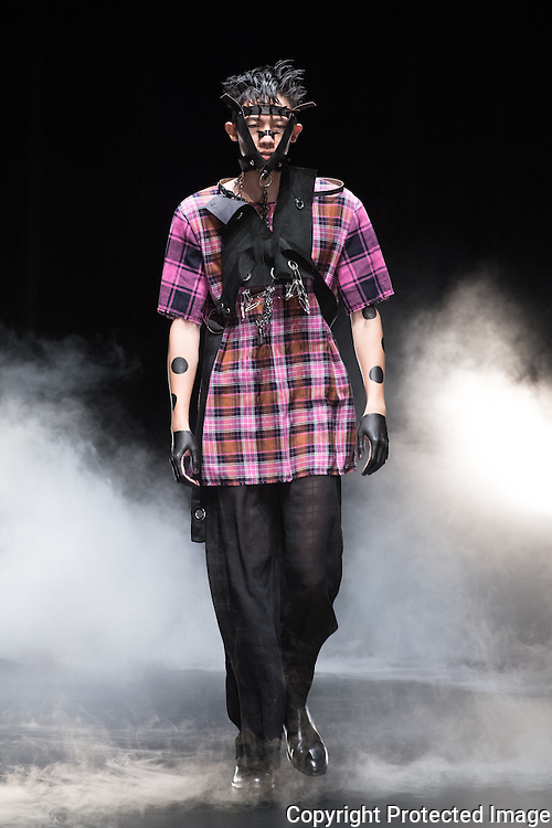 OCTOBER 19: A model  presents the Johan Ku Gold Label collection at the Amazon Fashion Week Tokyo's 2017 Spring/Summer show under way at Shibuya Hikarie in Tokyo on Oct. 19, 2016. and other locations through 23rd. Johan Ku was born in Taiwan, his designs is creating dynamic expressions through the combination of sculpture-like silhouettes with the unique textures of knitted fabric. Nearly 50 fashion brands and companies will hold their shows at several locations through 23rd.. 19/10/2016-Tokyo, JAPAN