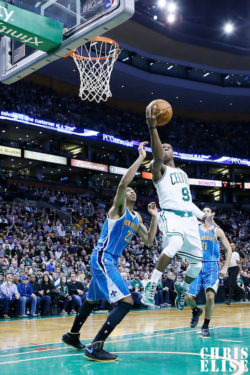 16 January 2013: Boston Celtics point guard Rajon Rondo (9) goes for the layup past New Orleans Hornets power forward Anthony Davis (23) during the New Orleans Hornets 90-78 victory over the Boston Celtics at the TD Garden, Boston, Massachusetts, USA.