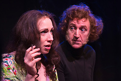 © Licensed to London News Pictures. 26/01/2016. London, UK. David Boyle as Marty Feldman and Rebecca Vaughan as Lauretta Feldman. Monty Python's Terry Jones directs Jeepers Creepers, a play about the powerful and complex partnership between Marty Feldman and his wife Lauretta. The comedy was written by Marty's biographer Robert Ross and is starring David Boyle as Marty Feldman and Rebecca Vaughan as Lauretta Feldman. Four-week run premiers at the Lounge at Leicester Square Theatre from 18 January to 20 February 2016. Photo credit: Bettina Strenske/LNP