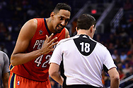 Feb 13, 2017; Phoenix, AZ, USA; New Orleans Pelicans center Alexis Ajinca (42) argues a call with referee Matt Boland (18) in the first half of the NBA game against the Phoenix Suns at Talking Stick Resort Arena. Mandatory Credit: Jennifer Stewart-USA TODAY Sports