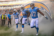 The L A Chargers enter the pitch during the International Series match between Tennessee Titans and Los Angeles Chargers at Wembley Stadium, London, England on 21 October 2018.