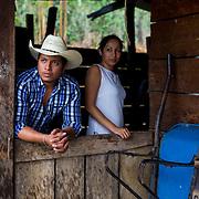 Coffee farmers Rogelio Manuel Gonzalez Velasco and Emilse Moreno Perez wait for rain to stop at Rancho Bonito coffee farm in the Jaltenango region of Chiapas. Photographed on May 17, 2016. (Joshua Trujillo, Starbucks)