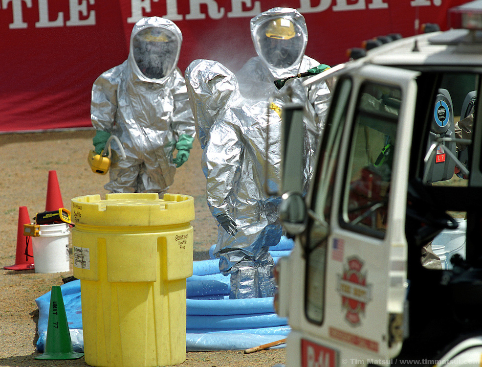 Seattle Fire Department personnel decontaminate after responding to a mock terrorist attack south of downtown on Monday, May 12, 2003 in Seattle, Washington. Controllers set off an explosion shortly after noon which simulated the detonation of a radioactive dispersal device or 'dirty bomb.'