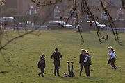 As the UK Prime Minister Boris Johnson suffers from Coronavirus and remains in intensive care in hospital - and a record 938 UK daily deaths were recorded, a total of 7,097, Londoners keep to government guidelines for daily exercise and practicing social distancing in Ruskin Park, a green space in Herne Hill, Lambeth, on 8th April 2020, in south London, England.
