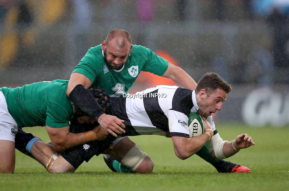 Barbarians Summer Tour Match, Thomond Park, Limerick 28/5/2015 <br /> Ireland XV vs Barbarians<br /> Barbarians' Alex Cuthbert is tackled by Ireland&rsquo;s Dan Tuohy<br /> Mandatory Credit &copy;INPHO/Billy Stickland