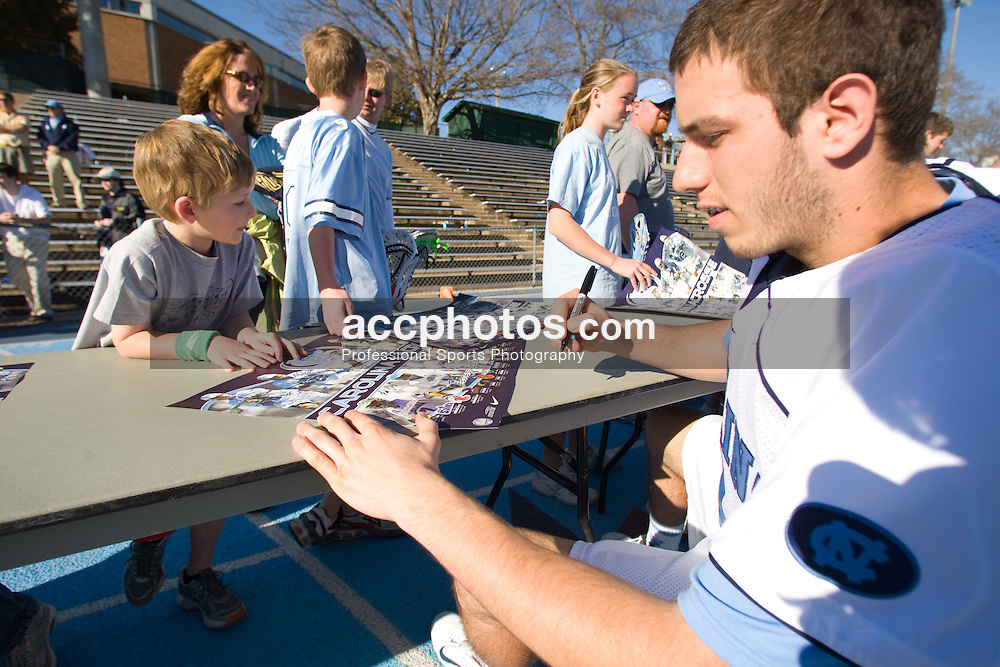 02 March 2008: North Carolina Tar Heels goalkeeper Chris Madalon (11) signs autographs for fans after a 13-8 win over the Cornell Big Red on Fetzer Field in Chapel Hill, NC.