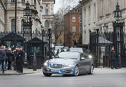 © Licensed to London News Pictures. 06/12/2017. London, UK. The Prime Minister's car speeds through the front gates of Downing Street as she heads to Parliament for Prime Minister's Questions. Yesterday a plot to attack Downing Street and kill Mrs May was revealed. Two men have appeared in court this morning.  Photo credit: Peter Macdiarmid/LNP