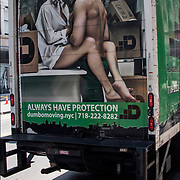 &quot;Always Have Protection&quot;  Couple semi- nude having sex in back of moving truck for DUMBO MOVING &amp; STORAGE. <br /> <br /> Humorous play on words &quot;Always Have Protection&quot;.<br /> <br /> Sex is everywhere in the American Culture today. advertising billboard on back of truck  in which sex is used to sell a product.