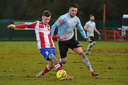 Dorking Wanderers James McShane in action against  Lewes FC Jack Dixon during the Ryman League - Div One South match between Dorking Wanderers and Lewes FC at Westhumble Playing Fields, Dorking, United Kingdom on 28 January 2017. Photo by Jon Bromley.