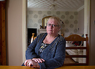 Margaret Lewis, pictured at her home in Kirkby, Liverpool. Mrs Lewis faces the prospect of having to pay additional money for rent with the introduction of the so-called Bedroom Tax, which comes into effect in April 2013. She lost her son Carl, then 18, at the Hillsborough football stadium disaster in 1989 and may have to move to a smaller property than the one in which she brought up her son. The street which she lives was renamed in Carl's honour around 15 years ago.